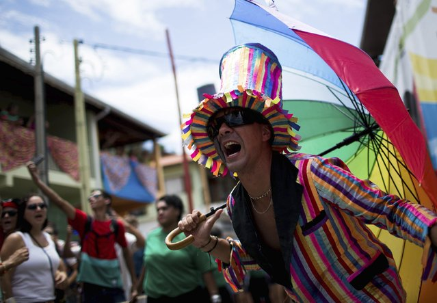 """Revellers take part in an annual carnival block party known as """"Juca Teles"""" in Sao Luiz do Paraitinga February 14, 2015. (Photo by Roosevelt Cassio/Reuters)"""
