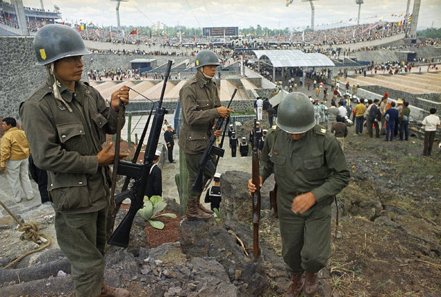 In this October 12, 1968 file photo, soldiers stand guard for the opening ceremony of the Summer Olympics in Mexico City, one week after soldiers opened fire on a peaceful demonstration, which has come to be known as the Tlatelolco massacre. In 1968, students struggled against a monolithic government that presided over a booming economy and was at the height of its power. (Photo by AP Photo)