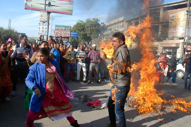 A man accidentally catches fire from a burning effigy of the Punjab government at Fauji Chowk during a teachers protest in Bathinda, India on December 21, 2016. (Photo by Sanjeev Kumar/Hindustan Times via Getty Images)