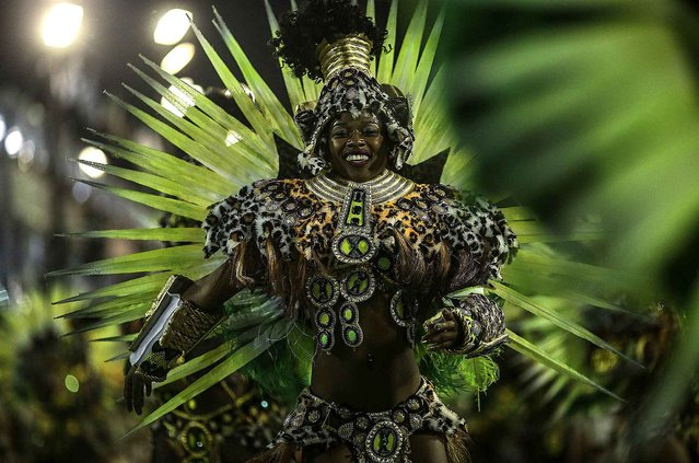 A member of Samba school Mocidade takes part in a parade, based on Don Quixote, as part of first day of parades of special group's samba schools during Rio de Janeiro's Carnival at Sambadrome in Rio de Janeiro, Brazil, early morning February 8, 2016. (Photo by Antonio Lacerda/EFE/Sipa USA)