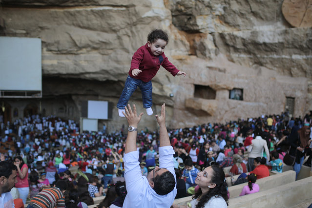 Egyptian Orthodox Christians celebrate Palm Sunday during a service in the Samaan el-Kharaz Church in the Mokattam district of Cairo, Egypt, Sunday, April 5, 2015. (Photo by Mosa'ab Elshamy/AP Photo)