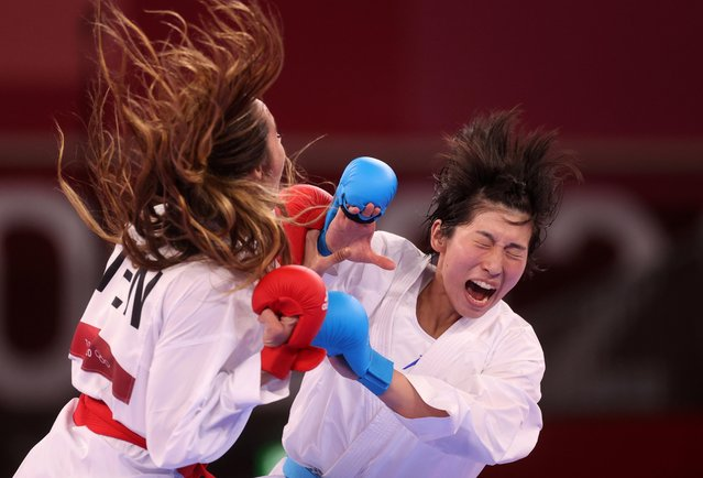 Japan's Mayumi Someya (R) competes against Venezuela's Claudymar Garces Sequera in the women's kumite -61kg elimination round of the karate competition during the Tokyo 2020 Olympic Games at the Nippon Budokan in Tokyo on August 6, 2021. (Photo by Carl Recine/Reuters)