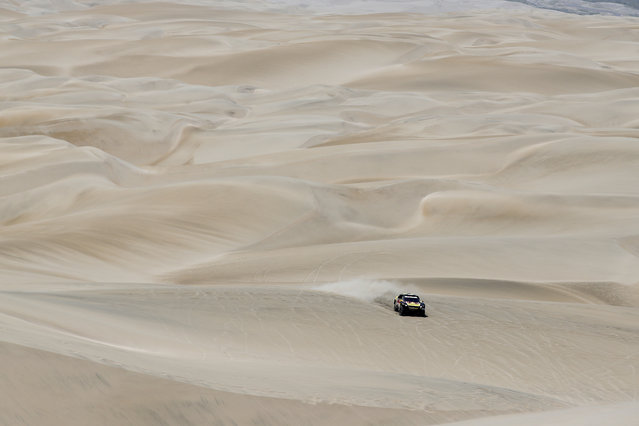 Driver Sebastien Loeb, of France, and co-driver Daniel Elena, of Monaco, race their Peugeot during the stage six of the Dakar Rally between Arequipa and San Juan de Marcona, Peru, Sunday, January 13, 2019. (Photo by Ricardo Mazalan/AP Photo)