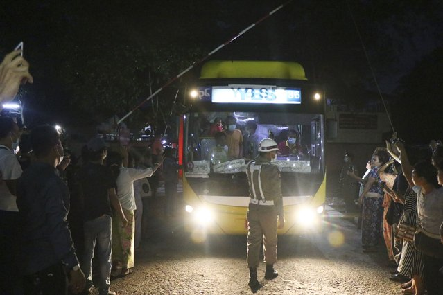 A bus with released prisoners onboard is driven out of Insein Prison in Yangon, Myanmar, Wednesday, June 30, 2021. Myanmar's government began releasing about 2,300 prisoners on Wednesday, including activists who were detained for protesting against the military's seizure of power in February and journalists who reported on the protests, officials said. (Photo by AP Photo/Stringer)