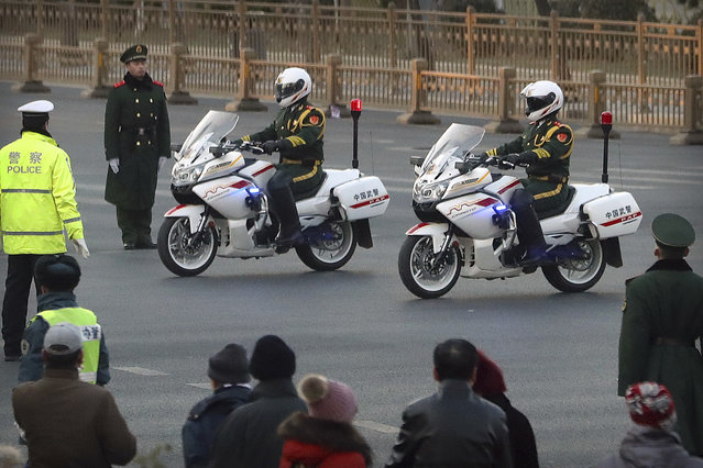 Chinese paramilitary police on motorcycles escort a motorcade believed to be carrying North Korean leader Kim Jong Un passes along a street in Beijing, Wednesday, January 9, 2019. North Korean state media reported Tuesday that Kim is making a four-day trip to China in what's likely an effort by him to coordinate with his only major ally ahead of a summit with U.S. President Donald Trump that could happen early this year. (Photo by Mark Schiefelbein/AP Photo)