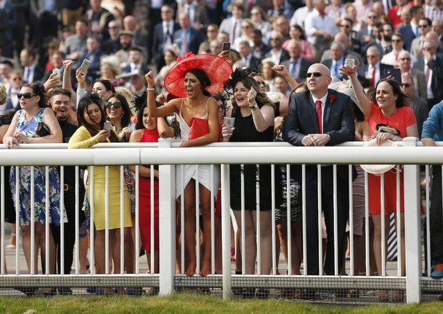 Horse Racing – Crabbie's Grand National Festival – Aintree Racecourse April 10, 2015: Racegoers celebrate during the 2.15 the E-Lites Top Novices' Hurdle Race. (Photo by Darren Staples/Reuters)