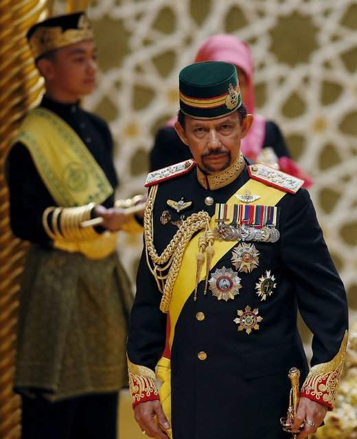 "Brunei's Sultan Hassanal Bolkiah attends the wedding of his son Prince Abdul Malik and Dayangku Raabi'atul 'Adawiyyah Pengiran Haji Bolkiah during the ""bersanding"" or enthronement ceremony at their wedding in the Nurul Iman Palace in Bandar Seri Begawan April 12, 2015. Brunei's Sultan Hassanal Bolkiah is one of the world's richest men. (Photo by Olivia Harris/Reuters)"