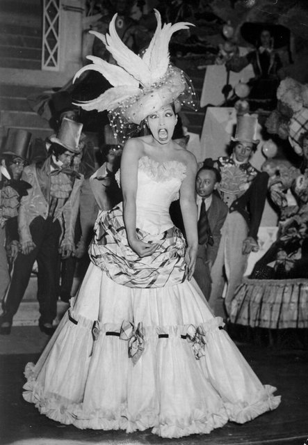 In this February 21, 1949 file photo, singer and dancer Josephine Baker performs during a show in Paris. The remains of American-born singer and dancer Josephine Baker will be reinterred at the Pantheon monument in Paris, making the entertainer who is a World War II hero in France the first Black woman to get the country's highest honor. Le Parisien newspaper reported Sunday Aug. 22, 2021, that French President Emmanuel Macron decided to organize a ceremony on November 30 at the Paris monument. (Photo by AP Photo/File)