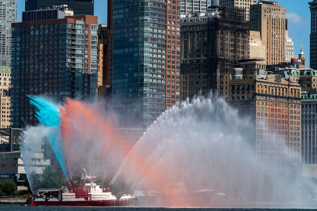 FDNY fireboat sprays water during the 9/11 Boatlift 20th Anniversary Tribute in New York City, New York, U.S., September 10, 2021. (Photo by Jeenah Moon/Reuters)