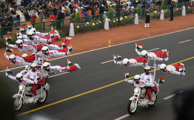 The Indian Military Police' s Dare Devil stunt team take part in a dsiplay during the Republic Day Parade at Rajpath in New Delhi on January 26, 2017. Motorbike stunt riders and herds of camels wowed the crowds gathered in the centre of New Delhi January 26 to celebrate Republic Day, an annual showcase of India' s military hardware and cultural diversity. After the presidents of the United States and France attended the last two extravaganzas, the Crown Prince of Abu Dhabi Mohammed bin Zayed Al Nahyan was this year' s chief guest as everyone from elite troops to schoolchildren paraded down the landmark Rajpath boulevard. (Photo by Prakash Singh/AFP Photo)