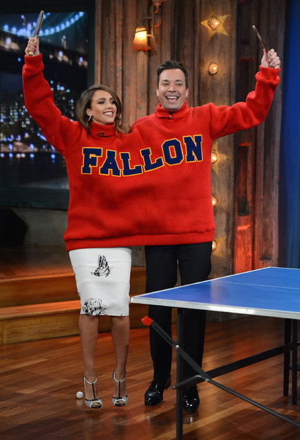 "Jessica Alba and Jimmy Fallon play a game of ""Double Turtleneck Ping Pong"" during a taping of ""Late Night With Jimmy Fallon"" at NBC Studios in NYC on January 20, 2014 in New York City. (Photo by Theo Wargo/Getty Images)"