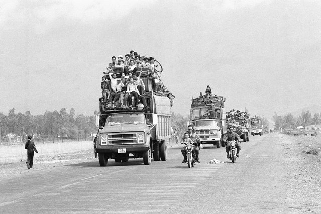 Trucks and motorbikes, loaded with refugees, roar along the main highway from the old imperial capital of Hue to the port city of Danang about 50 miles south of Hue, March 25, 1975. Hue?s 200,000 inhabitants have been streaming southward since the Saigon government's decision to abandon the city in the face of a heavy North Vietnamese buildup. (Photo by AP Photo)