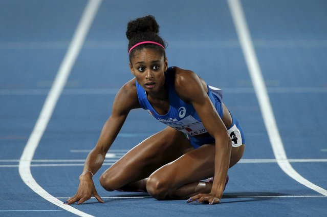 Maria Benedict Chigbolu of Italy looks uo after falling near the finish line during round one of the women's 4 x 400 meters race at the IAAF World Relays Championships in Nassau Bahamas, May 2, 2015. (Photo by Mike Segar/Reuters)
