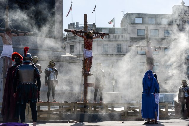 "Actor James Burke-Dunsmore stands on a crucifix whilst playing Jesus during The Wintershall's ""The Passion of Jesus"" in front of crowds on Good Friday at Trafalgar Square on March 25, 2016 in London, England. The Wintershall's theatrical production of 'The Passion of Jesus' includes a cast of 100 actors, horses, a donkey and authentic costumes of Roman soldiers in the 12th Legion of the Roman Army. Good Friday is a Christian religious holiday before Easter Sunday, which commemorates the crucifixion of Jesus Christ on the cross. (Photo by Chris Ratcliffe/Getty Images)"