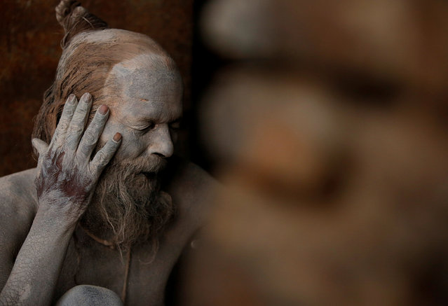 A Hindu holy man, or sadhu, smears ashes on his face at the premises of Pashupatinath Temple, ahead of the Shivaratri festival in Kathmandu, Nepal February 21, 2017. (Photo by Navesh Chitrakar/Reuters)