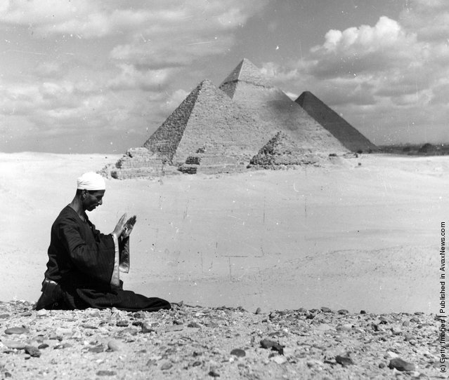 1955: A Muslim at prayer with the Pyramids as a backdrop