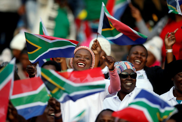 Guests sing as they arrive for the inauguration of Cyril Ramaphosa as President, at Loftus Versveld stadium in Pretoria, South Africa, May 25, 2019. (Photo by Siphiwe Sibeko/Reuters)