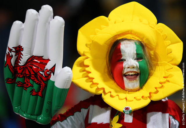 A young Wales fan cheers on her team during the IRB 2011 Rugby World Cup Pool D match between Wales and Namibia at Stadium Taranaki