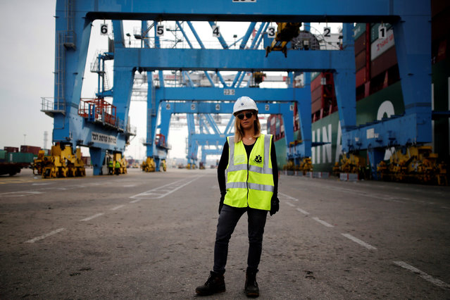 """Liz Azoulay, 26, who loads and unloads cargo at Ashdod port, poses for a photograph at the port, in Ashdod, southern Israel, February 22, 2017. """"In most of my professional life I did not face any inequality. In the port of Ashdod we are equal on the docks. I am the first woman who began working at the Ashdod port as a stevedore"""". (Photo by Amir Cohen/Reuters)"""