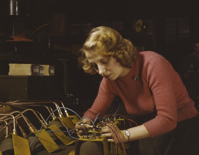 Heil and Co. employee Lucile Mazurek works on black-out lamps to be used on Air Force gasoline trailers, Milwaukee, Wisconsin, February 1943. (Photo by Howard R. Hollem/Getty Images)