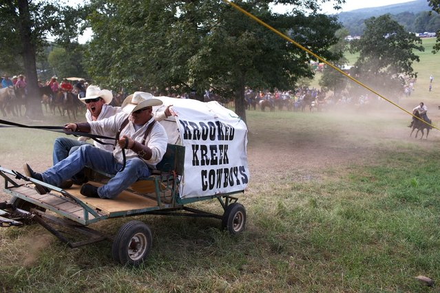 Labor Day weekend marked the 28th Annual National Chuckwagon Races in Clinton, Arkansas. The three-day event includes several divisions of chuckwagon and mule races, as well as rodeo events, live music and dancing. (Photo by Sol Neelman)
