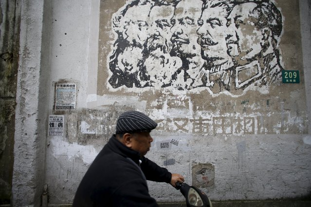 A resident rides a electric bicycle past an image that was painted during the Cultural Revolution and depicts German philosophers Karl Marx and Friedrich Engels, Soviet leaders Nikolai Lenin and Joseph Stalin, and Chinese leader Mao Zedong (L-R) on a wall at a soon-to-be demolished housing area in Shanghai, China, April 25, 2016. (Photo by Aly Song/Reuters)