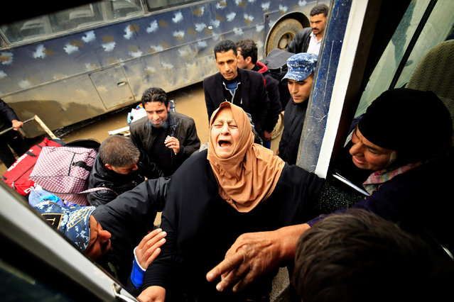 A displaced Iraqi woman, who fled from clashes, reacts as she is transferred to a safe area during a battle between Iraqi forces and Islamic State militants, in Mosul, Iraq March 17, 2017. (Photo by Thaier Al-Sudani/Reuters)