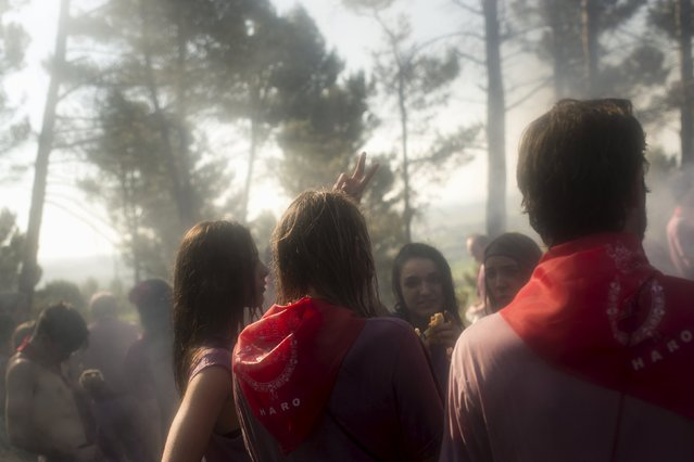 Smoke is seen as revellers dry off with fires following the Batalla de Vino (Wine Battle) in Haro, northern Spain June 29, 2015. (Photo by Vincent West/Reuters)