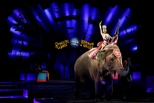 """A performer waves as she rides an elephant during a performance in Ringling Bros and Barnum & Bailey Circus' """"Circus Extreme"""" show at the Mohegan Sun Arena at Casey Plaza in Wilkes-Barre, Pennsylvania, U.S., April 29, 2016. (Photo by Andrew Kelly/Reuters)"""