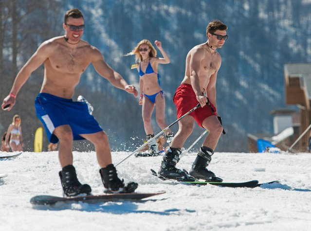 People dressed in swimsuits participate in the BoogelWoogel alpine carnival at the Rosa Khutor Alpine Resort in Krasnaya Polyana, Sochi, Russia on April 1, 2017. (Photo by Artur Lebedev/TASS)