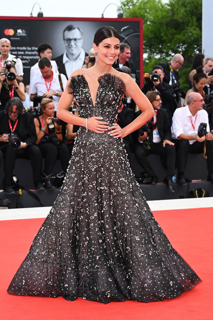 "Italian actress and sponsor of the Festival, Alessandra Mastronardi poses as she arrives for the opening ceremony and the screening of the film ""La Verite"" (The Truth) presented in competition on August 28, 2019 during the 76th Venice Film Festival at Venice Lido. (Photo by Alberto Pizzoli/AFP Photo)"