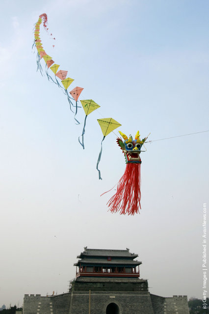A dragon kite flies over the Yongding Gate