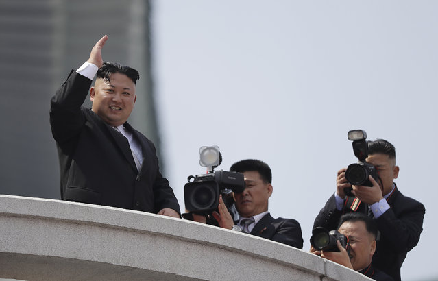 North Korean leader Kim Jong Un waves during a military parade on Saturday, April 15, 2017, in Pyongyang, North Korea to celebrate the 105th birth anniversary of Kim Il Sung, the country's late founder and grandfather of current ruler Kim Jong Un. (Photo by Wong Maye-E/AP Photo)
