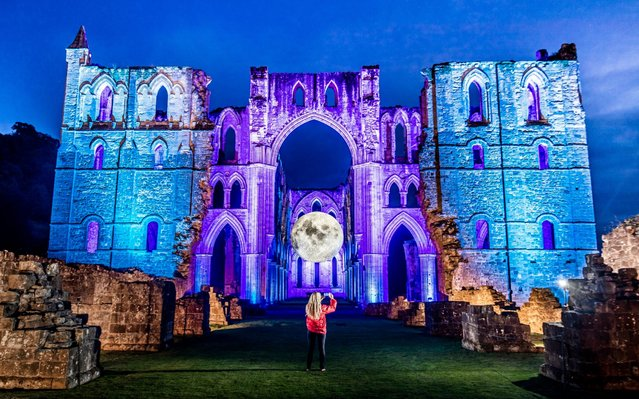"Luke Jerram's ""Museum of the Moon"" at English Heritage's Illuminating Rievaulx installation at Rievaulx Abbey, near Helmsley, North Yorkshire, England on September 18, 2019. (Photo by Danny Lawson/PA Images via Getty Images)"