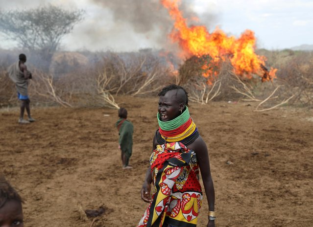 A Turkana tribeswoman reacts after an accidental fire of a shelter in Turkana settlement in Ilemi Triangle, Kenya, July 15, 2019. (Photo by Goran Tomasevic/Reuters)