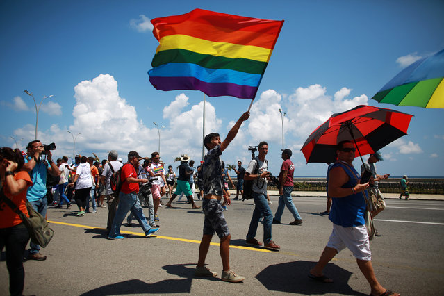 Gay rights activists get together before the Annual March against Homophobia and Transphobia in Havana, May 14, 2016. (Photo by Alexandre Meneghini/Reuters)
