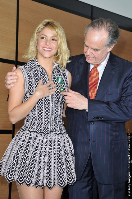 Shakira poses with French Culture Minister, Frederic Mitterrand after being honored at Hotel Majestic