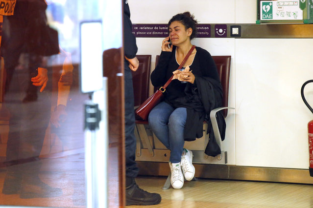 A relative of the victims of the EgyptAir flight 804 that crashed, reacts as she makes a phone call at Charles de Gaulle Airport outside of Paris, Thursday, May 19, 2016. Egyptian aviation officials say an EgyptAir flight from Paris to Cairo with 66 passengers and crew on board has crashed. (Photo by Michel Euler/AP Photo)