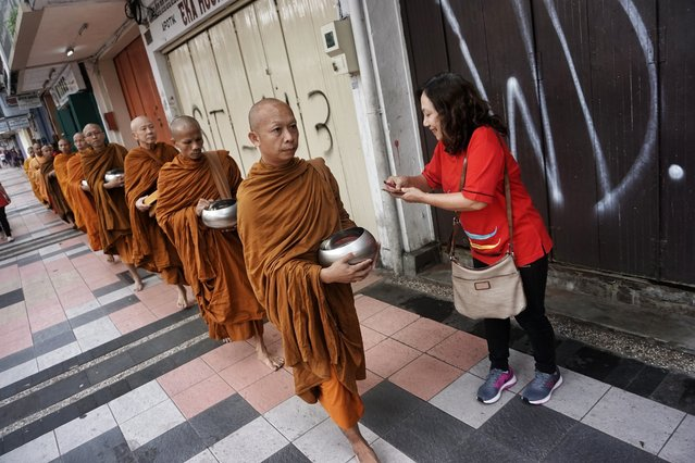 Buddhist monks walks around the street during the procession of Pindapata in Magelang, Central Java, Indonesia on May 10, 2017. Pindapata is one of the series of commemoration sacred day of Vesak for Buddhist. The holy day celebrates the birth, the enlightenment to nirvana, and the passing of Gautama Buddha's, the founder of Buddhism. (Photo by Nugroho Hadi Santoso/NurPhoto via Getty Images)