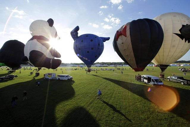 Inflated hot air balloons prepare to fly during the 33rd annual QuickChek New Jersey Festival of Ballooning at Solberg Airport Friday, July 24, 2015, in Readington, N.J. (Photo by Mel Evans/AP Photo)