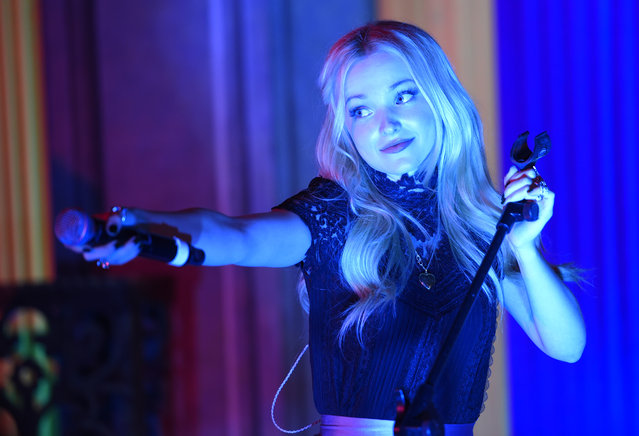"Dove Cameron, a cast member in the Disney Channel original movie ""Descendants"", performs for the crowd at the post-premiere party for the film at Walt Disney Studios on Friday, July 24, 2015, in Burbank, Calif. (Photo by Chris Pizzello/Invision/AP Photo)"