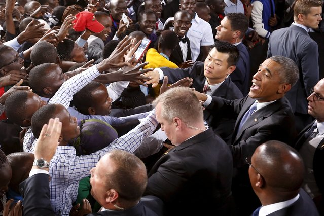 The crowd surges toward U.S. President Barack Obama as he greets the audience after his remarks at an indoor stadium in Nairobi July 26, 2015. Obama told Kenya on Saturday the United States was ready to work more closely in the battle against Somalia's Islamist group al Shabaab, but chided his host on gay rights and said no African state should discriminate over sexuality. (Photo by Jonathan Ernst/Reuters)