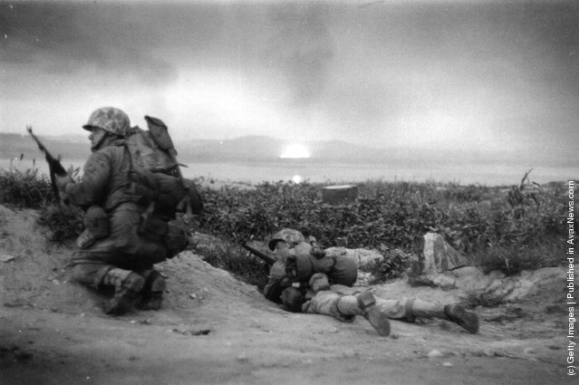 US Marines of the UN invasion force which landed at Inchon in South Korea, advance inland during the Korean War