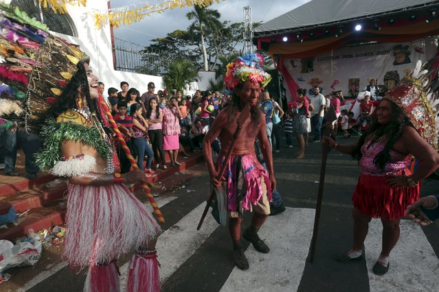 People dressed as Red Indian dance during celebrations honouring the patron saint of Managua, Santo Domingo de Guzman, in Managua, Nicaragua July 31, 2015. (Photo by Oswaldo Rivas/Reuters)