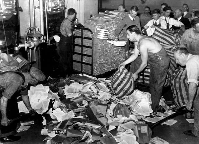 U.S. Postal employees feed 17 tons of reading matter, labeled by postal authorities as propaganda, into a furnace in San Francisco, California, on March 19, 1941. The bulk of the newspapers, books, and pamphlets came from Nazi Germany and some from Russia, Italy and Japan