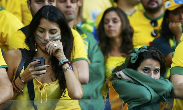 Fans of Brazil react during their 2014 World Cup semi-finals against Germany at the Mineirao stadium in Belo Horizonte July 8, 2014. (Photo by Eddie Keogh/Reuters)