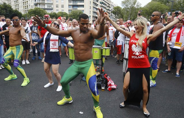 Football Soccer, EURO 2016, Marseille, France on June 21, 2016. Brazilian dancers and a Poland fan dance in Marseille, France.      REUTERS/Yves Herman
