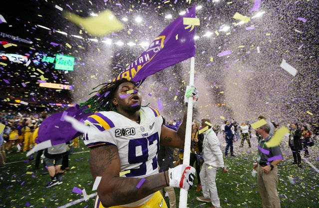 LSU Tigers defensive end Glen Logan (97) celebrates after the LSU Tigers defeated the Clemson Tigers in the College Football Playoff national championship game at Mercedes-Benz Superdome in New Orleans, Louisiana, January 13, 2020. (Photo by Derick E. Hingle/USA TODAY Sports)