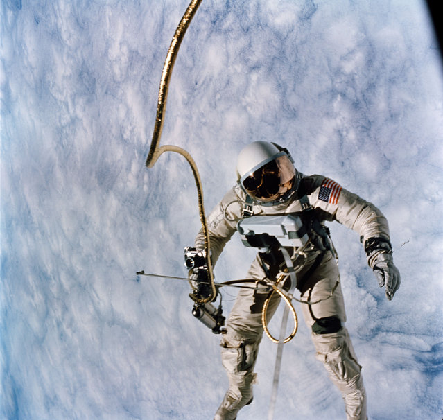 Astronaut Edward H. White II, pilot for the Gemini-Titan 4 (GT-4) spaceflight, floats in the zero-gravity of space during the third revolution of the GT-4 spacecraft on June 3, 1965. White wears a specially designed spacesuit. His face is shaded by a gold-plated visor to protect him from unfiltered rays of the sun. (Photo by NASA)