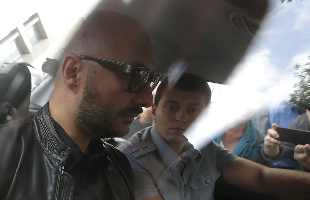 Russian theatre director Kirill Serebrennikov (front), who was accused of embezzling state funds and placed under house arrest, sits in a car as he is escorted after a court hearing in Moscow, Russia September 4, 2017. (Photo by Maxim Shemetov/Reuters)